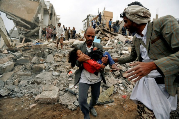 A man carries Buthaina Muhammad Mansour, an injured girl rescued from the site of a Saudi-led air strike in Sanaa, Yemen, on August 25, 2017.