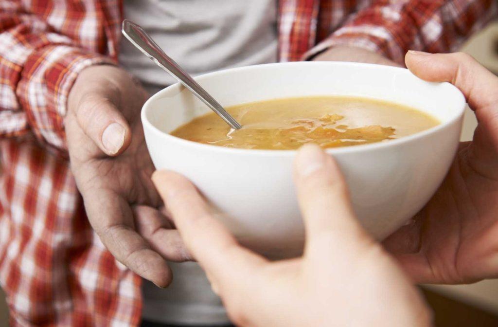 man-receiving-soup-bowl-1024x672.jpg